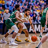 12 March 2019: University of Vermont Catamount Forward Anthony Lamb, a Junior from Toronto, Ontario, in action against the Binghamton University Bearcats at Patrick Gymnasium in Burlington, Vermont. Lamb finished the game with 18 points and a career-high seven assists as the top-seeded Catamounts advanced to their fourth-straight AE conference championship game, defeating the Bearcats 84-51. Mandatory Credit: Ed Wolfstein Photo *** RAW (NEF) Image File Available ***