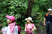Tourists visiting the Jiuzhaigou National Park. Sichuan Province. China.