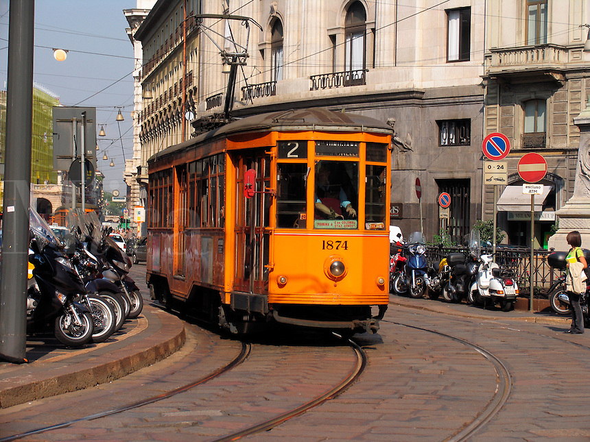 Trolley car and scooters, Milan, Ital