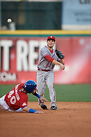 Syracuse Chiefs second baseman Corban Joseph (3) throws to first base as Jarrod Saltalamacchia (40) slides into second base during a game against the Buffalo Bisons on May 18, 2017 at Coca-Cola Field in Buffalo, New York.  Buffalo defeated Syracuse 4-3.  (Mike Janes/Four Seam Images)