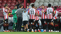 Brentford Manager, Thomas Frank speaks to his players in the water break during Brentford vs West Bromwich Albion, Sky Bet EFL Championship Football at Griffin Park on 26th June 2020