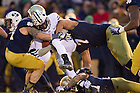 Nov. 23, 2013; Linebacker Carlo Calabrese (44) and defensive end Stephon Tuitt (7) bring down BYU Cougars running back Jamaal Williams (21).<br /> <br /> Photo by Matt Cashore