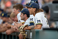 Michigan Wolverines outfielder Jordan Brewer (22) in the dugout against the Vanderbilt Commodores during Game 2 of the NCAA College World Series Finals on June 25, 2019 at TD Ameritrade Park in Omaha, Nebraska. Vanderbilt defeated Michigan 4-1. (Andrew Woolley/Four Seam Images)