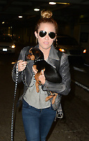 MIAMI, FL - MAY 14: Singer Miley Cyrus, mom Trish Cyrus  and older sister Brandi Cyrus arriving at Miami International Airport with Miley's newly adopted rescue pup.  on May 14, 2012 in Miami, Florida<br /> <br /> <br /> People:  Miley Cyrus