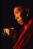 Monk Holding Teacup in Pokhara, Nepal, 1990