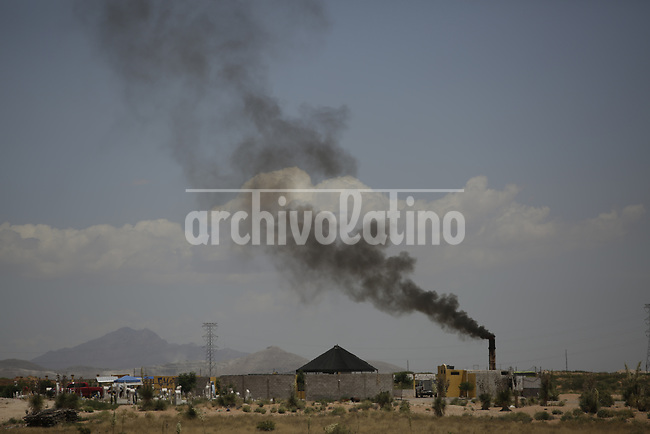 Smoke arises from a cremation furnace at the cementery of Ciudad Juarez during the Covid 19 pandemic . on the Mexican border with the USA. Amidst the never ending violence of this city in the border with the USA, corona virus is taking a high death toll.