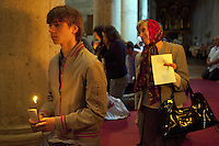 """Italy. Lazio region. Tivoli. Several people, all romanian citizens, kneel during the orthodox sunday mass. The orthodox religious service takes place in a catholic church """" Chiesa di San Pietro alla Carita"""". Romanian immigration. Tivoli is a town and comune in the province of Rome.  02.10.2011 © 2011 Didier Ruef"""