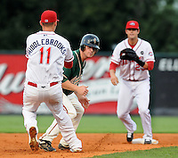 August 13, 2009: Paul Gran (15) of the Greensboro Grasshoppers is caught off second base in a rundown by Will Middlebrooks (11) and Casey Kelly (23) of the Greenville Drive during a game at Fluor Field at the West End in Greenville, S.C. Photo by: Tom Priddy/Four Seam Images