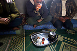Bedouin who make their living smuggling goods and humans from Egypt across the Gaza and Israel borders drink tea in a home in the Sinai peninsula, near the border with Gaza, Jan. 28, 2010. A barrier wall being built buy Egypt may impact the illegal trade, causing strife between the government and Egypt's marginalized Bedouin tribes.