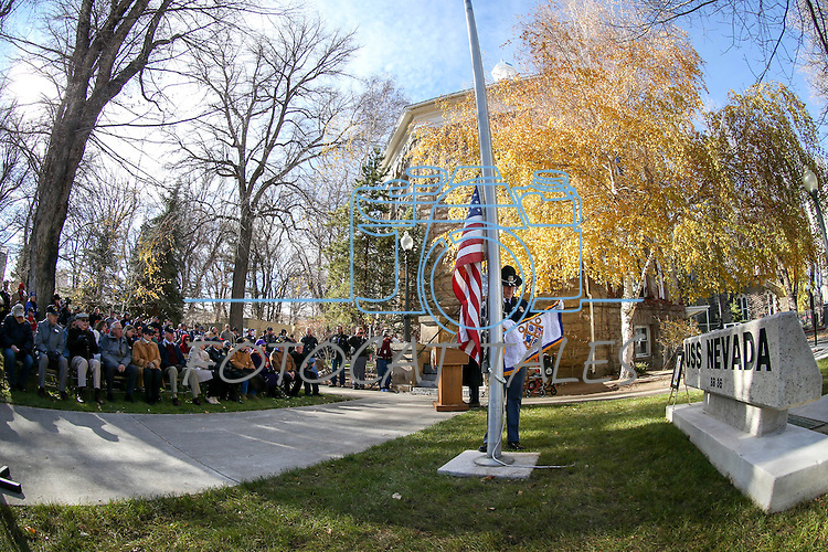 John Butler, with the Nevada State Capitol Police, raises the flag during the Pearl Harbor 75th Commemoration at the U.S.S. Nevada memorial at the Capitol in Carson City, Nev. on Wednesday, Dec. 7, 2016. <br /> Photo by Cathleen Allison/Nevada Photo Source