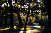 Belgrade, Serbia. Sava Park; delightful autumn or late summer evening light; woman in silhouette walking.