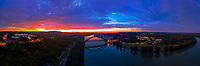 Wow! This is the most beautiful sunrise panorama of the 360 Pennybacker Bridge! I captured this spectacular color-drenched aerial panorama of the sun rising over the 360 Pennybacker Bridge in west Austin, Texas. It was a blistering cold December morning, but I wear my thermals and love the quite stillness and beauty of the morning while everyone is still asleep.