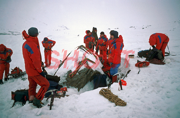 Mountain rescue team assembling during a winter call prior to moving onto steeper terrain. This image may only be used to portray the subject in a positive manner..©shoutpictures.com..john@shoutpictures.com