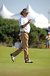 Miguel Angel Jimenez of Spain celebrates his putt on the 13th  during day one of The Senior Open Golf Tournament at The Royal Porthcawl Golf Club in South Wales this afternoon.