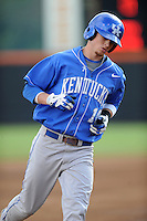 Second Baseman J.T. Riddle #10 rounds third after hitting a home run during a  game against the Tennessee Volunteers at Lindsey Nelson Stadium on March 24, 2012 in Knoxville, Tennessee. The game was suspended in the bottom of the 5th with the Wildcats leading 5-0. Tony Farlow/Four Seam Images.