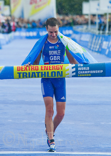 07 AUG 2011 - LONDON, GBR - Alistair Brownlee (GBR), with the flag of Yorkshire wrapped around his shoulders, celebrates winning the men's round of triathlon's ITU World Championship Series and meeting the selection criteria for the British team for the 2012 Olympic Games (PHOTO (C) NIGEL FARROW)