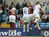 Arsenal vs Leeds United - Womens FA Cup Final at Millwall Football Club - 01/05/06 - Arsenal's Asante and Ludlow are beaten in the air by Preston and Walker - (Gavin Ellis 2006)