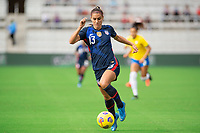 ORLANDO CITY, FL - FEBRUARY 21: Alex Morgan #13 of the USWNT dribbles the ball during a game between Brazil and USWNT at Exploria Stadium on February 21, 2021 in Orlando City, Florida.