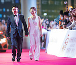 Ken Chu and his wife Audrey walk the Red Carpet event at the World Celebrity Pro-Am 2016 Mission Hills China Golf Tournament on 20 October 2016, in Haikou, China. Photo by Victor Fraile / Power Sport Images