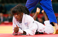 29 JUL 2012 - LONDON, GBR - Priscilla Gneto (FRA) of France recovers after holding off a move from Kyung-Ok Kim (KOR) of South Koriea during their women's -52kg category repechage contest in the London 2012 Olympic Games judo at the ExCel Exhibition Centre in London, Great Britain (PHOTO (C) 2012 NIGEL FARROW)