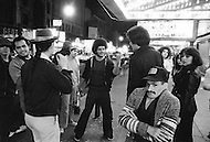 Manhattan, New York City, NY. May, 1980.<br /> Group of people on the streets of Time Sq. at night. Times Square had acquired a reputation as a dangerous neighborhood during the 1980's.  The shabiness of the area, especially due its go-go bars, sex shops, and adult theaters, became an infamous symbol of the city's decline.