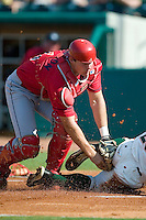 Lakewood catcher Lou Marson tags out Greensboro DH Gary Roche (26) at home plate at First Horizon Park in Greensboro, NC, Sunday, July 16, 2006.  The Grasshoppers defeated the BlueClaws 7-4.