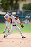GCL Rays shortstop Kevin Santiago (4) throws to first during the first game of a doubleheader against the GCL Red Sox on August 9, 2016 at JetBlue Park in Fort Myers, Florida.  GCL Rays defeated GCL Red Sox 5-4.  (Mike Janes/Four Seam Images)