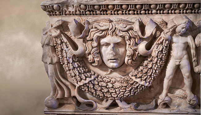 Roman relief garland  sculpted sarcophagus, style typical of Pamphylia, 3rd Century AD, Konya Archaeological Museum, Turkey. Against a warm art background.