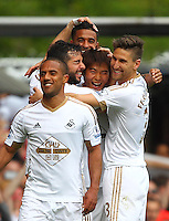 Ki Sung-yueng of Swansea celebrates scoring his sides third goal with team-mates   during the Barclays Premier League match between West Ham United and Swansea City  played at Boleyn Ground , London on 7th May 2016
