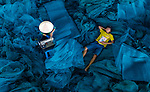 Mending nets by Bui Van Hai
