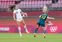 KASHIMA, JAPAN - JULY 27: Alex Morgan #13 of the USWNT goes up for a header with Ellie Carpenter #12 of Australia during a game between Australia and USWNT at Ibaraki Kashima Stadium on July 27, 2021 in Kashima, Japan.