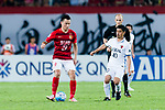 Guangzhou Forward Gao Lin (L) fights for the ball with Kashima Midfielder Ogasawara Mitsuo (R) during the AFC Champions League 2017 Round of 16 match between Guangzhou Evergrande FC (CHN) vs Kashima Antlers (JPN) at the Tianhe Stadium on 23 May 2017 in Guangzhou, China. (Photo by Power Sport Images/Getty Images)
