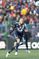 Sporting Kansas City defender Aurelien Collin (78) heads the ball to keeper.  In a Major League Soccer (MLS) match, Sporting Kansas City (blue) tied the New England Revolution (white), 0-0, at Gillette Stadium on March 23, 2013.