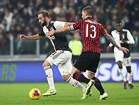 Calcio, Serie A: Juventus - Milan, Turin, Allianz Stadium, November 10, 2019.<br /> Juventus' Gonzalo Higuain (l) in action with Milan's captain Alessio Romagnoli (r) during the Italian Serie A football match between Juventus and Milan at the Allianz stadium in Turin, November 10, 2019.<br /> UPDATE IMAGES PRESS/Isabella Bonotto