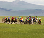 Children race horses across the steppe in northern Mongolia; a child's light weight allows the horse to run at maximum speed. The annual race is part of the much anticipated Naadam Festival, which features other events such as archery and wrestling.
