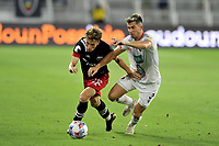 WASHINGTON, DC - JULY 7: Griffin Yow #22 of D.C. United  battles for the ball with Fernan Faerron #3 of Liga Deportiva Alajuense during a game between Liga Deportiva Alajuense  and D.C. United at Audi Field on July 7, 2021 in Washington, DC.