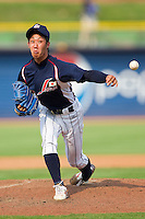 Relief pitcher Yuhei Nakaushiro #15 of the Japan Collegiate National Team in action against the USA Baseball Collegiate National Team at the Durham Bulls Athletic Park on July 3, 2011 in Durham, North Carolina.  USA defeated Japan 7-6.  (Brian Westerholt / Four Seam Images)