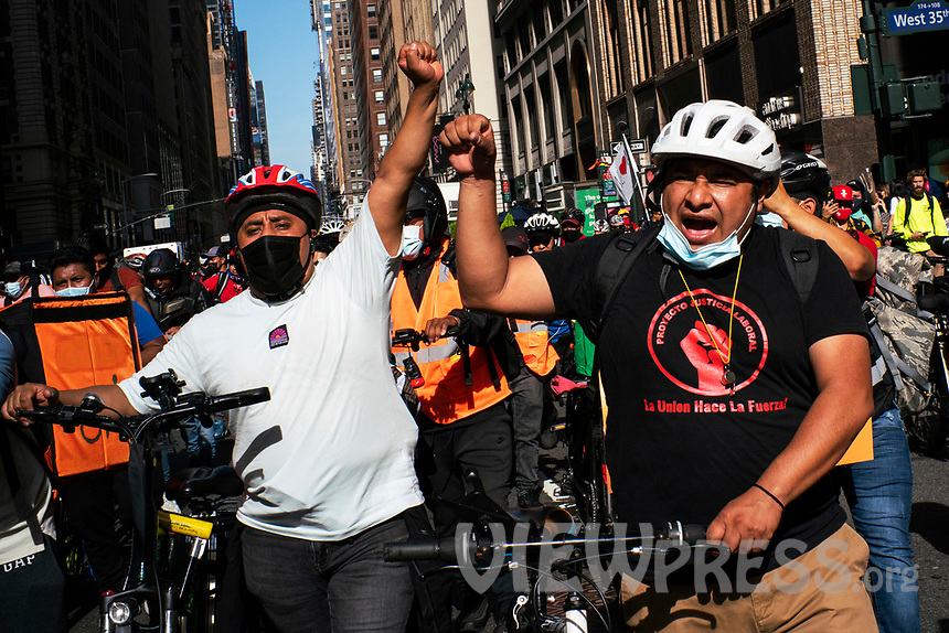 NEW YORK, NY - OCTOBER 15: Delivery workers take part in a protest to stop thefts of their bikes at Times Square on October 15, 2020 in New York, At least 4,477 bicycles have been reported stolen with an increase of 27 percent from same period last year, according to the police. (Photo by Eduardo MunozAlvarez/VIEWpress)