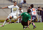 Mexico (26.02.2006) Monterrey Rayados midfielder Ricardo Martinez (R) fights for the ball with UNAM Pumas defender Fernando Morales as the referee  Roberto Garcia falls down on the green during their soccer match at the Mexico City's University Stadium, February 26, 2006. UNAM tied 0-0 to Monterrey. © Photo by Javier Rodriguez