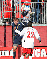 Rodney Wallace #22 of the University of Maryland watches Zac MacMath #1 grab the ball from Jacob Wilson #11 of the University of California during an NCAA championship round of sixteen soccer match at Ludwig Field, on November 29, 2008 in College Park, Maryland. The match was won by Maryland 2-1