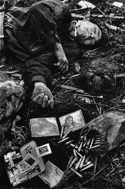 Dead North Vietnamese soldier and his plundered belongings, Têt offensive, Battle of Hué, Vietnam, February 1968