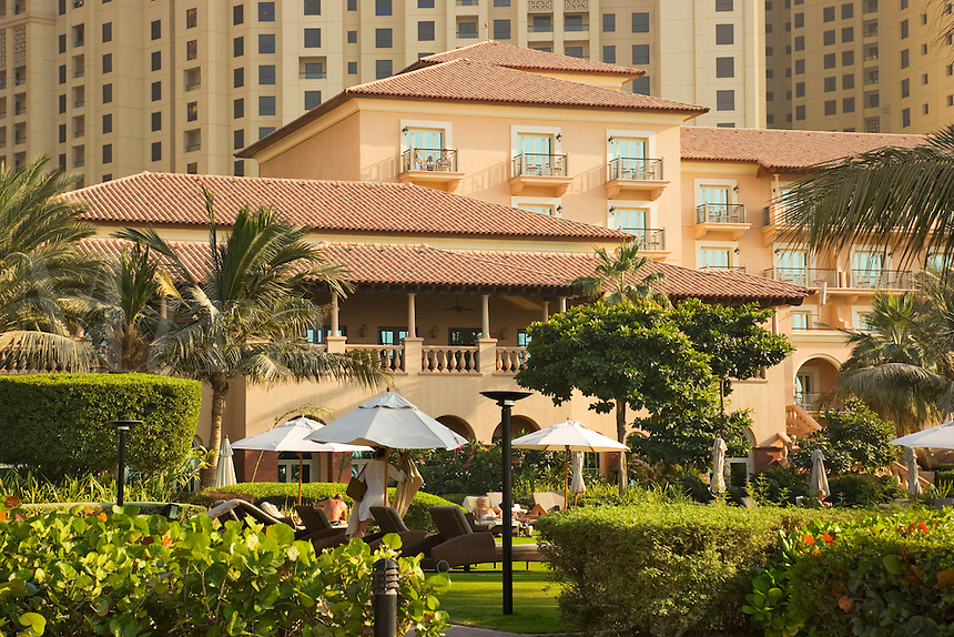 Dubai.  Ritz Carlton Hotel at Jumeirah Beach with the Jumeirah Residences high rise apartment blocks in background..