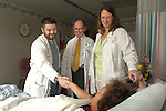 Dr. Ambrose and residents visiting patient.Williamsport Hospital
