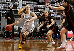 SIOUX FALLS, SD - MARCH 6: Tori Nelson #20 of the South Dakota State Jackrabbits drives to the basket past Akili Felici #3 of the Omaha Mavericks1 during the Summit League Basketball Tournament at the Sanford Pentagon in Sioux Falls, SD. (Photo by Dave Eggen/Inertia)
