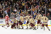 Bill Arnold (BC - 24), Steven Whitney (BC - 21), Patrick Wey (BC - 6), Pat Mullane (BC - 11), Kevin Hayes (BC - 12), Chris Kreider (BC - 19), Brian Dumoulin (BC - 2) and Tommy Cross (BC - 4) celebrate. - The Boston College Eagles defeated the Boston University Terriers 3-2 (OT) to win the 2012 Beanpot championship on Monday, February 13, 2012, at TD Garden in Boston, Massachusetts.
