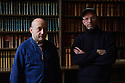 """Bristol, UK. 28.11.2015. Artists, John Wood and Paul Harrison, present """"Erdkunde: The Study of the Earth"""", a new video work inspired by Bristol Museum's geology collections. The work forms part of the New Expressions 3 series of new collaborations. Picture shows: Artists, John Wood and Paul Harrison, in the library at Bristol Museum. Photograph © Jane Hobson."""