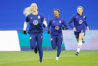 LE HAVRE, FRANCE - APRIL 13: Julie Ertz #8, Crystal Dunn #19 and Emily Sonnett #14 of the United States warming up before a game between France and USWNT at Stade Oceane on April 13, 2021 in Le Havre, France.