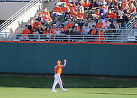 Head coach Jack Leggett (7) of the Clemson Tigers encourages the left field crowd before a game against the University of Alabama-Birmingham on Feb. 17, 2012, at Doug Kingsmore Stadium in Clemson, South Carolina. UAB won 2-1. (Tom Priddy/Four Seam Images)