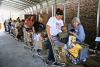 Appalachia, Ohio, USA.<br /> Literally hundreds of cars a day drive through this food distribution center. Without these foodbanks families wouldn't have the means to feed their children.