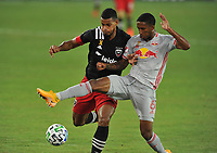 WASHINGTON, DC - SEPTEMBER 12: Gelmin Rivas #20 of D.C. United battles for the ball with Kyle Duncan #6 of New York Red Bulls during a game between New York Red Bulls and D.C. United at Audi Field on September 12, 2020 in Washington, DC.